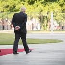 Prime Minister Boris Johnson walks with German Chancellor Angela Merkel (Stefan Rousseau/PA)