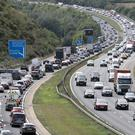 Drivers are being warned to expect delays on popular tourist routes (Andrew Matthews/PA)