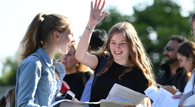 Grace Murray (right) and Lucy Garside celebrate with their GCSE results at Norwich School in Norwich, Norfolk (Joe Giddens/PA)