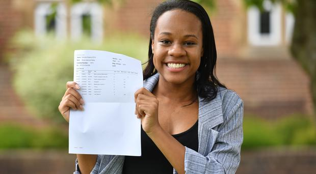 Alicia Daley, who suffers with chronic fatigue syndrome and fibromyalgia, showing off her grade 9 GCSE results at King Edward VI High School for Girls, in Birmingham. (Jacob King/PA)