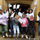 Pupils celebrate with their GCSE results at King Edward VI High School for Girls in Birmingham (Jacob King/PA)