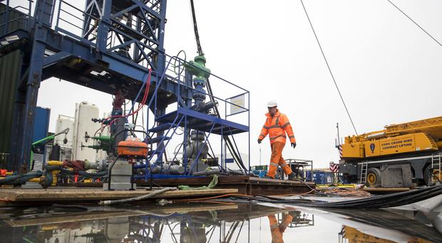 A worker at the Cuadrilla fracking site in Lancashire (Danny Lawson/PA)