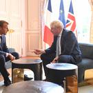Prime Minister Boris Johnson meets French President Emmanuel Macron at the Elysee Palace in Paris ahead of talks to try to break the Brexit deadlock.