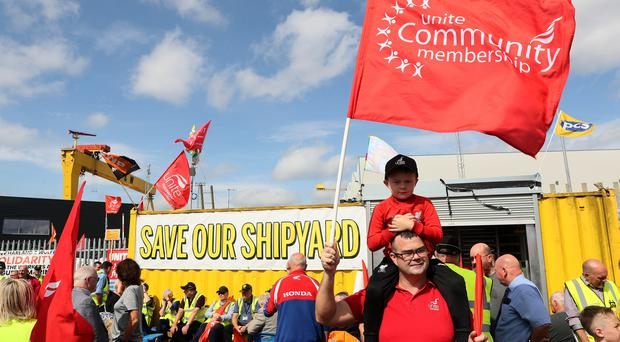 Unite shop steward Richard Shields and his son Lee, 5, attend a rally outside Harland and Wolff (Brian Lawless/PA)