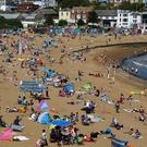 People enjoy the sunny weather on the beach in Broadstairs, Kent (Gareth Fuller/PA)