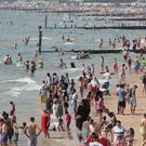 Beachgoers in Bournemouth were enjoying the hot Bank Holiday weather on Saturday (Andrew Matthews/PA)