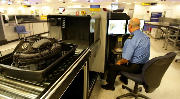 New scanners are being rolled out at UK airports (Dave Thompson/PA)