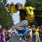 Dancers perform during the Children's Day parade at the Notting Hill Carnival (Victoria Jones/PA)