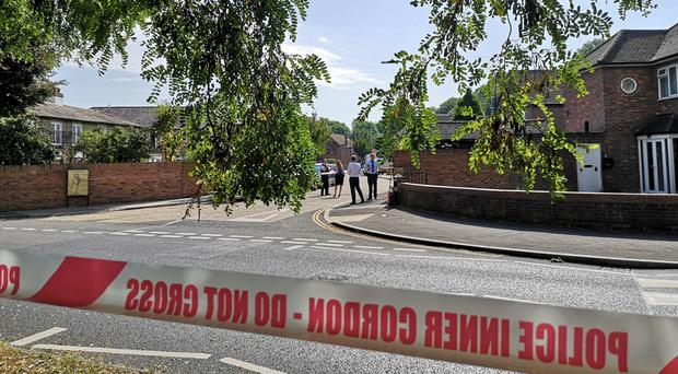 Police tape near the scene in Southall (Lewis Pennock/PA)