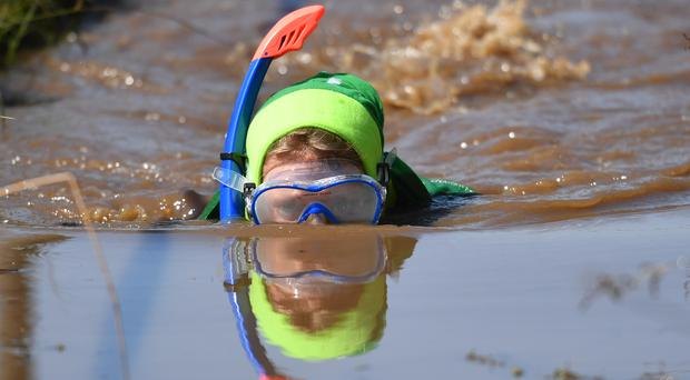 A competitor takes part in the World Bog Snorkelling Championships at Waen Rhydd peat bog in Llanwrtyd Wells, Wales.