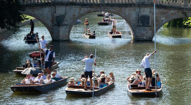 People punt along the River Cam in Cambridge, as the heatwave continues (Joe Giddens/PA)