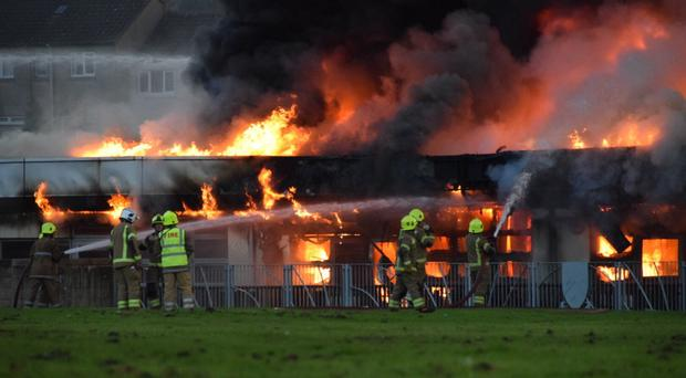 The blaze at Woodmill High School is being fought by more than 80 firefighters (Euan's Emergency Photography/PA)