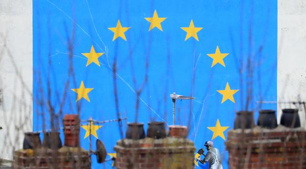 The Brexit-inspired mural by Banksy in Dover (PA)