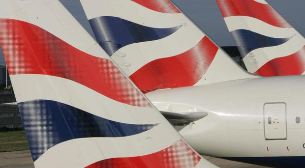 British Airways pilots are going on strike next month (Tim Ockenden/PA)