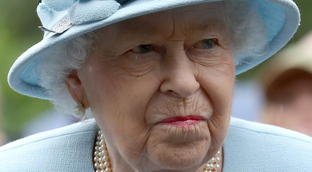 Staff working for the Queen are to receive a backdated pay increase. Andrew Milligan/PA Wire