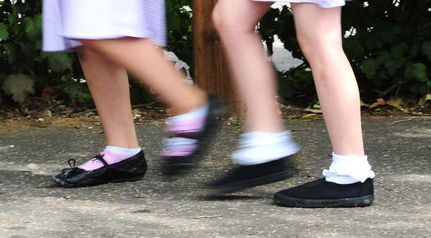 The Children's Society found around 219,000 children are unhappy with the state of their lives (PA)