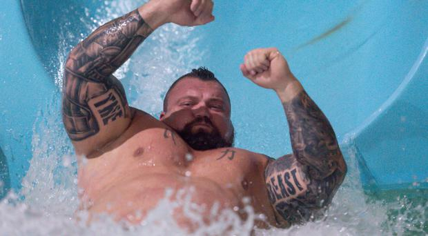 Former world's strongest man Eddie Hall while being dropped down the 'tallest and fastest' water slide in the UK, The Thunderbolt, at Waterworld (Jacob King/PA)