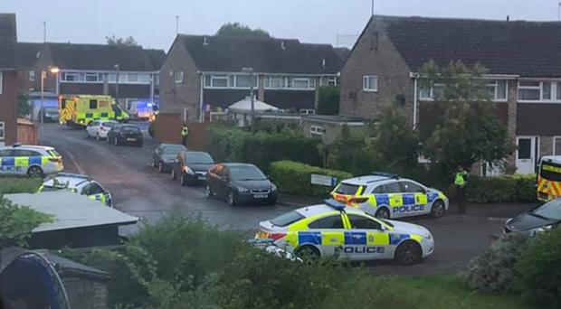 Police and emergency personnel near the Dockle Farmhouse and New Inn pubs in Swindon during a stand-off with a gunman ( Claire Louise Brookes/PA)