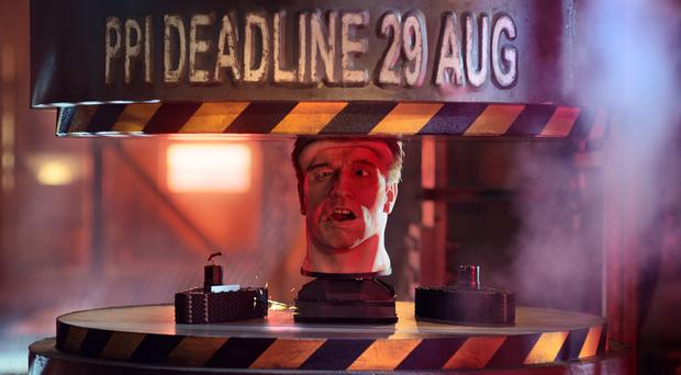 The animatronic head of Arnold Schwarzenegger being placed in a hydraulic press during an advert to remind people the deadline to complain about PPI (Financial Conduct Authority/PA)