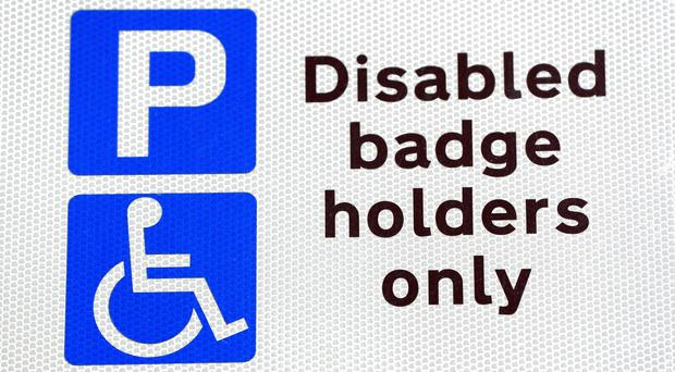 The eligibility criteria for blue badges is being extended (Jonathan Brady/PA)
