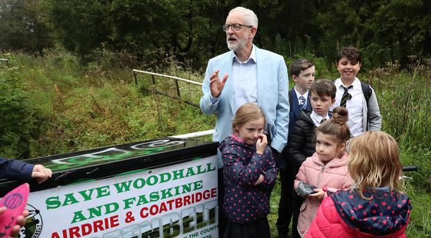 Labour leader Jeremy Corbyn joins campaigners during a visit to meet members of the Woodhall, Faskine and Palacecraig Conservation Group (Andrew Milligan/PA)