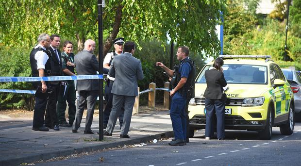 Police at the scene in Willan Road on the Broadwater Farm Estate in Tottenham (Kirsty O'Connor/PA)
