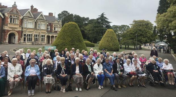 More than 80 veterans who played a vital but secret role in the efforts to end the Second World War at Bletchley Park (Georgina Stubbs/PA)