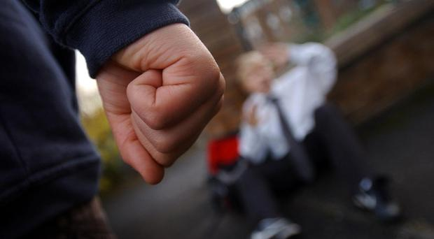 Pupils who are bullied tend to be left feeling anxious, according to new research (Danny Lawson/PA)