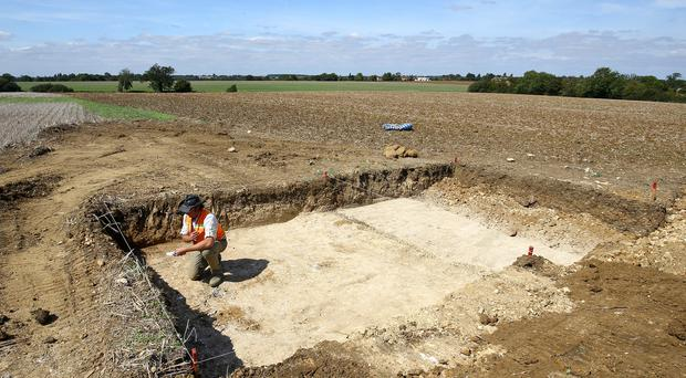 Brian Seymour of the United States Department of Defence, at an excavation site in a field near to Stansted Airport in Essex (Gareth Fuller/PA)