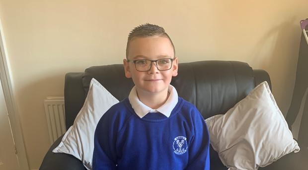 Eight-year-old Charlie returned to school on Tuesday(Brain Tumour Research/Handout)