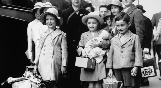 London evacuees with gas masks (in cardboard parcels) and luggage all set for evacuation from the capital to the other areas of the country, during the Second World War.