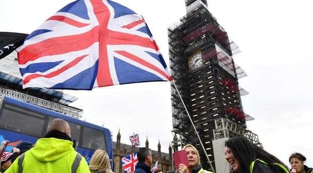A Brexit demonstration in Parliament Square (Dominic Lipinski/PA)