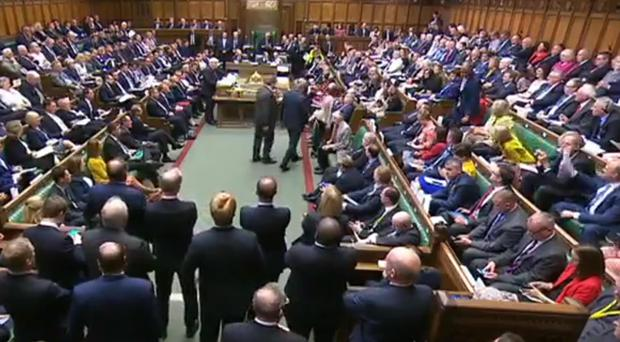 Phillip Lee (centre standing right) takes his seat among Liberal Democrat MPs (House of Commons/PA)