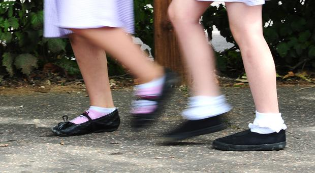 The report has found many children can not afford appropriate food or school uniforms (Ian West/PA)
