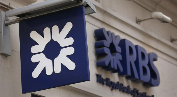 Royal Bank of Scotland has warned over a hit of up to £900 million for payment protection insurance after a last-minute surge in claims ahead of the August deadline (PA)
