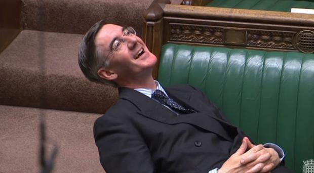 Leader of the House of Commons Jacob Rees-Mogg reclining on his seat in the House of Commons London (PA)