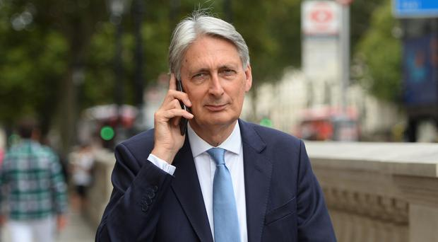 Former chancellor Philip Hammond has had the whip withdrawn (PA)
