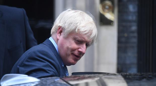 Prime Minister Boris Johnson leaves following a cabinet meeting at 10 Downing Street, London.