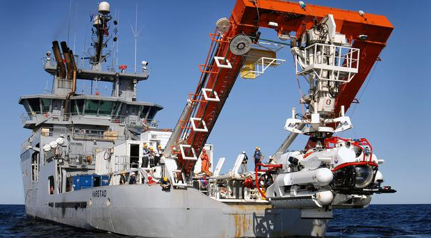The Nato Submarine Rescue System being lowered into the sea on a previous training exercise (Royal Navy/PA)