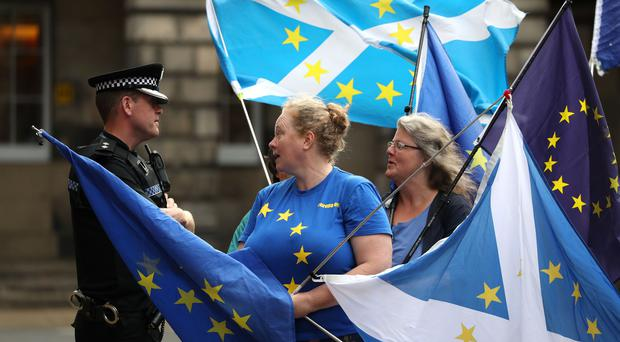 Pro-EU demonstrators have been held outside the Court of Session over the course of the legal actions (Andrew Milligan/PA)
