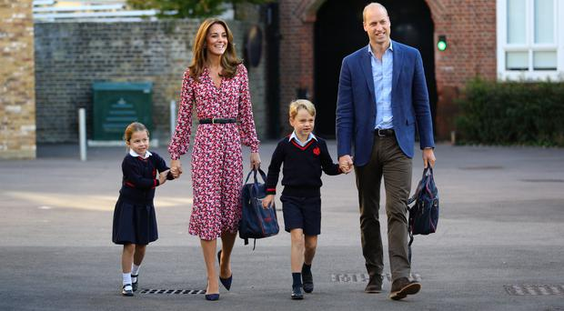Princess Charlotte, with her father, the Duke of Cambridge, mother, the Duchess of Cambridge, and brother,Prince George, arriving for her first day of school at Thomas's Battersea in London (Aaron Chown/PA)
