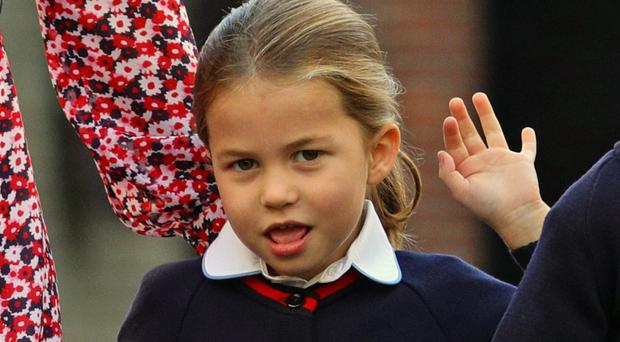 Princess Charlotte waves as she arrives for her first day of school (Aaron Chown/PA)