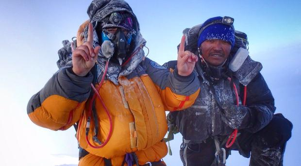 Mollie Hughes on the summit of Mount Everest (Mollie Hughes/PA)