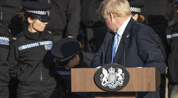 Boris Johnson reacts after a student officer needed to sit down as he made a speech (Danny Lawson/PA)