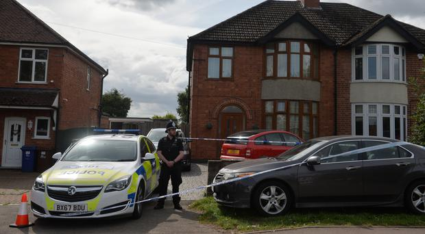 Police outside the house in Burton-on-Trent (Jacob King/PA)