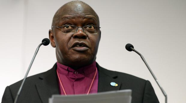 Dr John Sentamu did not wear a dog collar for 10 years in protest (PA)