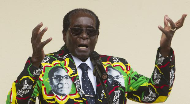 Zimbabwean President Robert Mugabe addresses people at an event before the closure of his party's 16th Annual People's Conference in Masvingo, south of the capital Harare (Tsvangirayi Mukwazhi/AP)