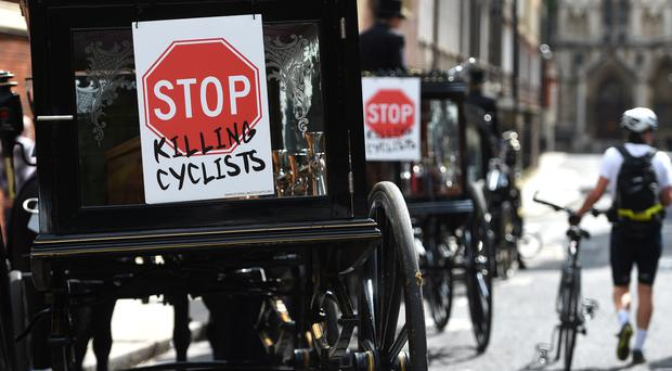 Protesters join a symbolic funeral procession through central London to highlight the number of cyclist deaths (David Mirzoeff/PA)