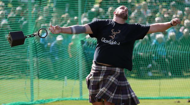 A competitor in the heavyweight class throws a weight at the Braemar Royal Highland Gathering (Andrew Milligan/PA)