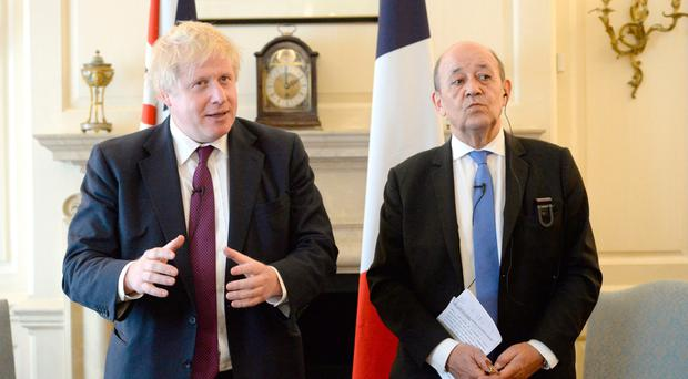 Boris Johnson with French Foreign Minister Jean-Yves Le Drian